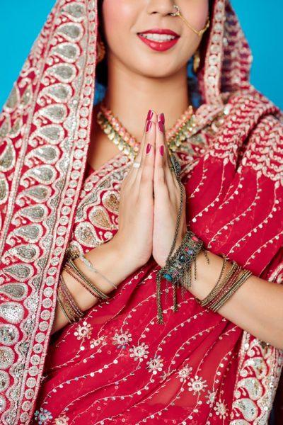 Indian bride making namaste gesture